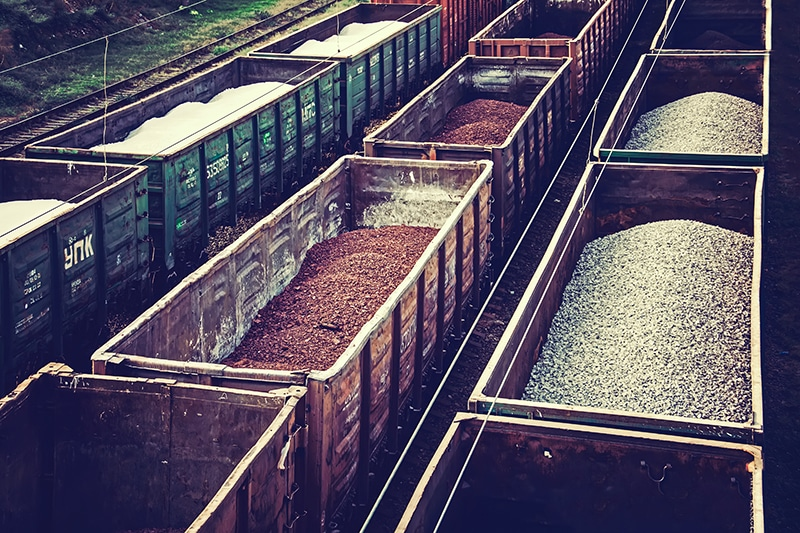 Loaded railcars from above. Cargo transportation by rail.